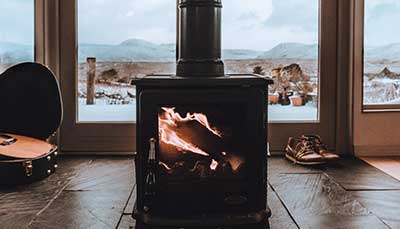 A warm wood burner inside a home during winter